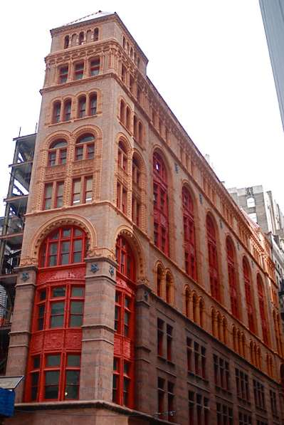 Restored Facade - Custom color given the name Shy Cherry.  Highlighting the intricate cast iron detailing  on this historic 1888 building.  Blasted and tripple paint system.                                    Located at 13 John Street, New York, NY 10038